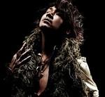 「ラルク・アン・シエル」のギタリスト・kenの顔写真
