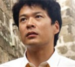 田中哲司の顔写真